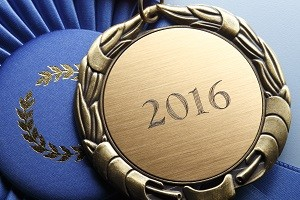 Gold Medal Engraved With 2016 Resting On Blue Ribbon